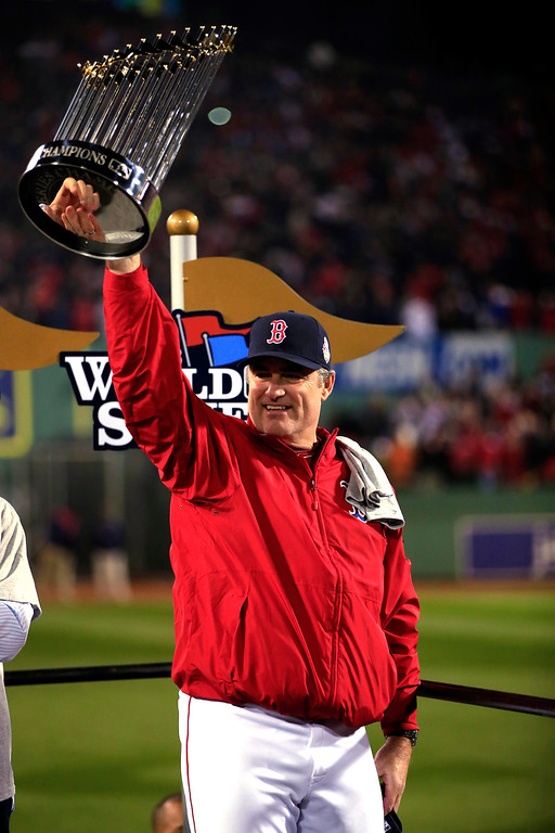 Description of . Manager John Farrell #53 of the Boston Red Sox holds up the World Series trophy after defeating the St. Louis Cardinals 6-1 in Game Six of the 2013 World Series at Fenway Park on October 30, 2013 in Boston, Massachusetts.  (Photo by Jamie Squire/Getty Images)
