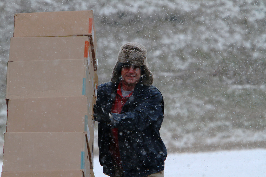 Description of . Frito Lay employee Ray Harris delivers chips to a store in Childersburg Alabama as a snow and ice storm came to the south Tuesday Jan. 28,  2014.  A fast-moving, unexpectedly severe winter storm blanketed much of Alabama with a treacherous layer of frozen precipitation Tuesday.   (AP Photo/Hal Yeager)