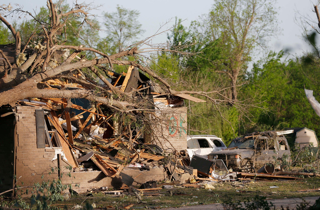Description of . A tornado-damaged home awaits clean up and repairs after a Sunday tornado in Baxter Springs, Kan., Monday, April 28, 2014. Sunday's tornado damaged dozens of buildings and injured at least 25 people. (AP Photo/Orlin Wagner)