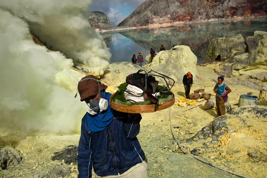 Description of . A miner carry a goats head for burial in the crater as part of an annual offering ceremony on the Ijen volcano on December 17, 2013 in Yogyakarta, Indonesia.  (Photo by Ulet Ifansasti/Getty Images)