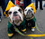 Vince, left, and Packer, sit for owner Ron Belin in the parking lot of Lambeau Field before an NFL football game between the Green Bay Packers and the Minnesota Vikings Sunday, Dec. 2, 2012, in Green Bay, Wis. (AP Photo/Mike Roemer)