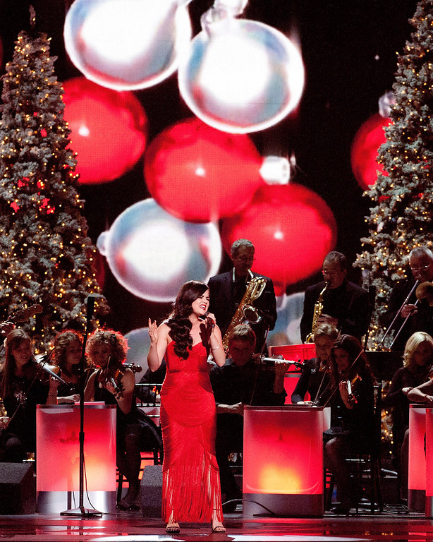 Description of . Lucy Hale performs during the CMA 2013 Country Christmas on November 8, 2013 in Nashville, Tennessee.  (Photo by Erika Goldring/Getty Images)
