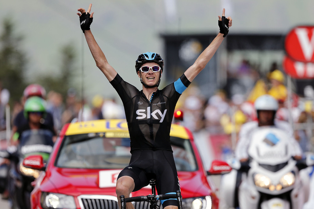 Description of . Britain's Christopher Froome celebrates as he crosses the finish line at the end of the 195 km eighth stage of the 100th edition of the Tour de France cycling race on July 6, 2013 between Castres and Ax 3 Domaines, southwestern France.  JEFF PACHOUD/AFP/Getty Images