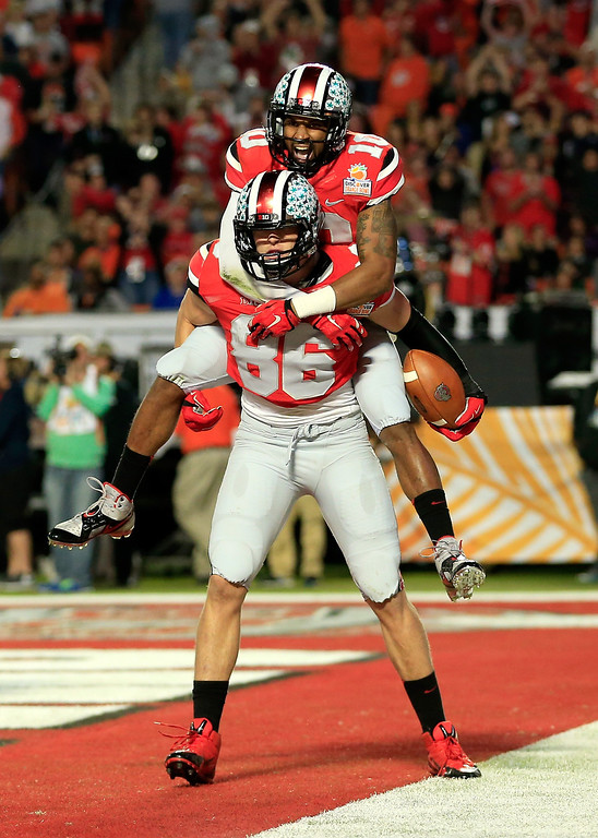 Description of . MIAMI GARDENS, FL - JANUARY 03: Jeff Heuerman #86 and Philly Brown #10 of the Ohio State Buckeyes celebrate after a touchdown by Heuerman in the second quarter against the Clemson Tigers during the Discover Orange Bowl at Sun Life Stadium on January 3, 2014 in Miami Gardens, Florida.  (Photo by Chris Trotman/Getty Images)