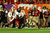 Lonnie Pryor #24 of the Florida State Seminoles scores a 60-yard rushing touchdown in the first quarter against Demetrius Stone #19 of the Northern Illinois Huskies  during the Discover Orange Bowl at Sun Life Stadium on January 1, 2013 in Miami Gardens, Florida.  (Photo by Mike Ehrmann/Getty Images)