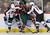 Minnesota Wild's Mikael Granlund, center, of Finland, is squeezed between Colorado Avalanche's Shane O'Brien, left, and Aaron Palushaj, right, in a battle for the puck in the first period of an NHL hockey game on Thursday, Feb. 14, 2013, in St. Paul, Minn. (AP Photo/Jim Mone)