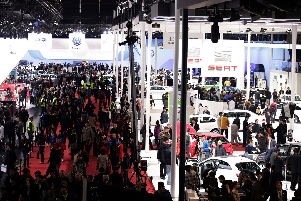 Description of . Guests stroll during the Shanghai International Automobile Industry Exhibition (AUTO Shanghai) media day in Shanghai, China Saturday, April 20, 2013. (AP Photo/Eugene Hoshiko)