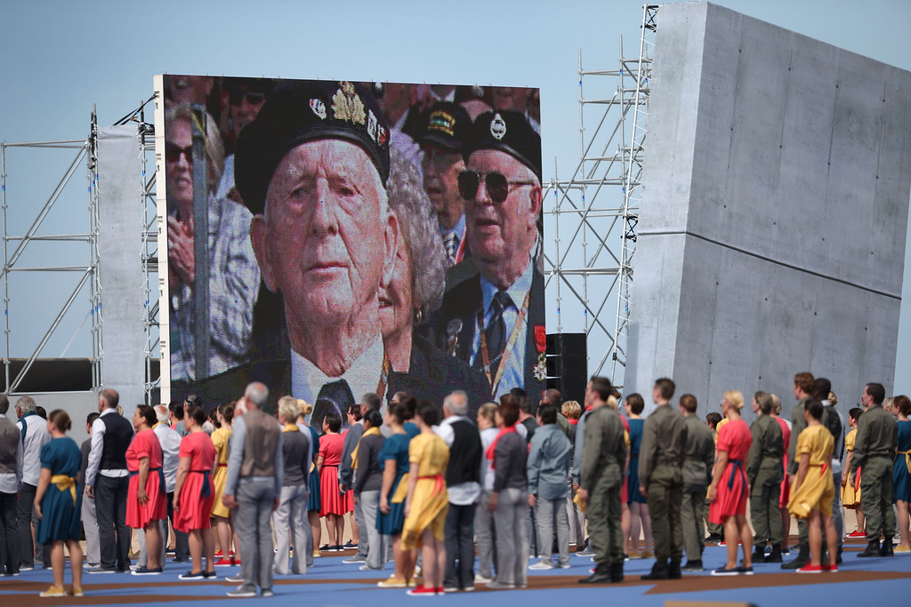 Description of . A video screen shows images of veterans during the International Ceremony at Sword Beach to commemorate the 70th anniversary of the D-Day Invasion on June 6, 2014 in Ouistreham, France. (Photo by Peter Macdiarmid/Getty Images)