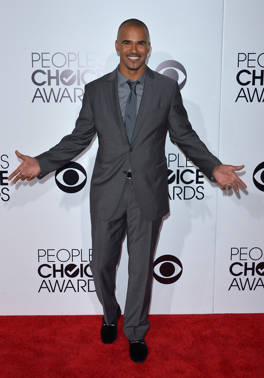 Description of . Shemar Moore arrives at the 40th annual People's Choice Awards at Nokia Theatre L.A. Live on Wednesday, Jan. 8, 2014, in Los Angeles. (Photo by John Shearer/Invision/AP)