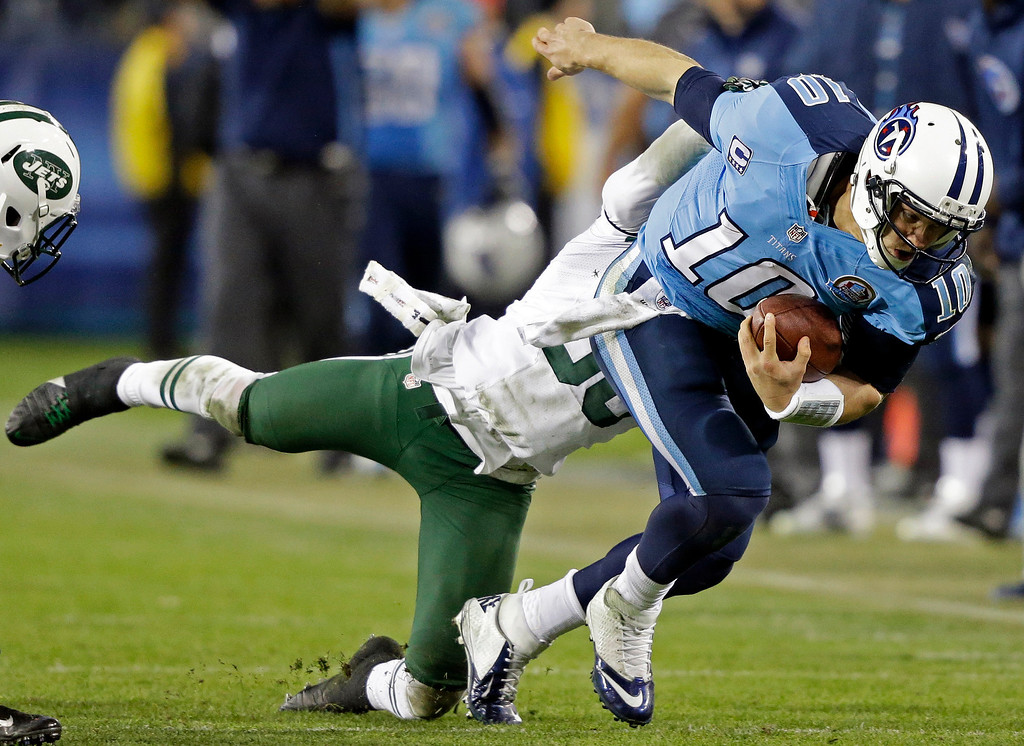 Description of . Tennessee Titans quarterback Jake Locker (10) is tackled by New York Jets free safety LaRon Landry (30) in the third quarter of an NFL football game, Monday, Dec. 17, 2012, in Nashville, Tenn. (AP Photo/Wade Payne)
