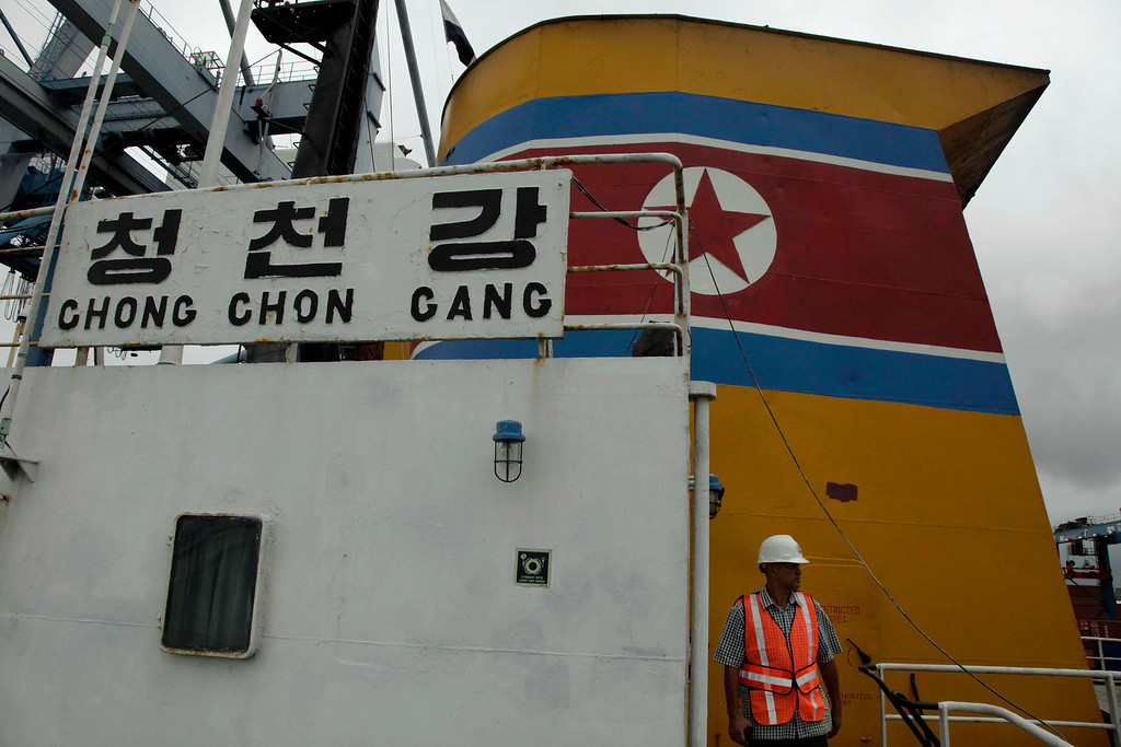 Description of . Panamanian presidential security detail walks on the deck aboard a North Korean-flagged ship at the Manzanillo International container terminal on the coast of Colon City, Panama, Tuesday, July 16, 2013.  (AP Photo/Arnulfo Franco)