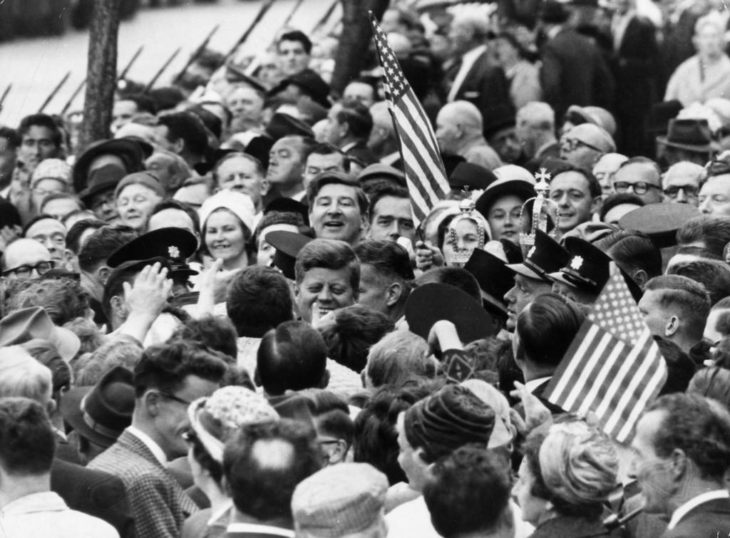 Description of . Kennedy is nearly lost in a crowd of well-wishers during his visit to Cork, Ireland,  on June 18, 1963.  Keystone/Getty Images