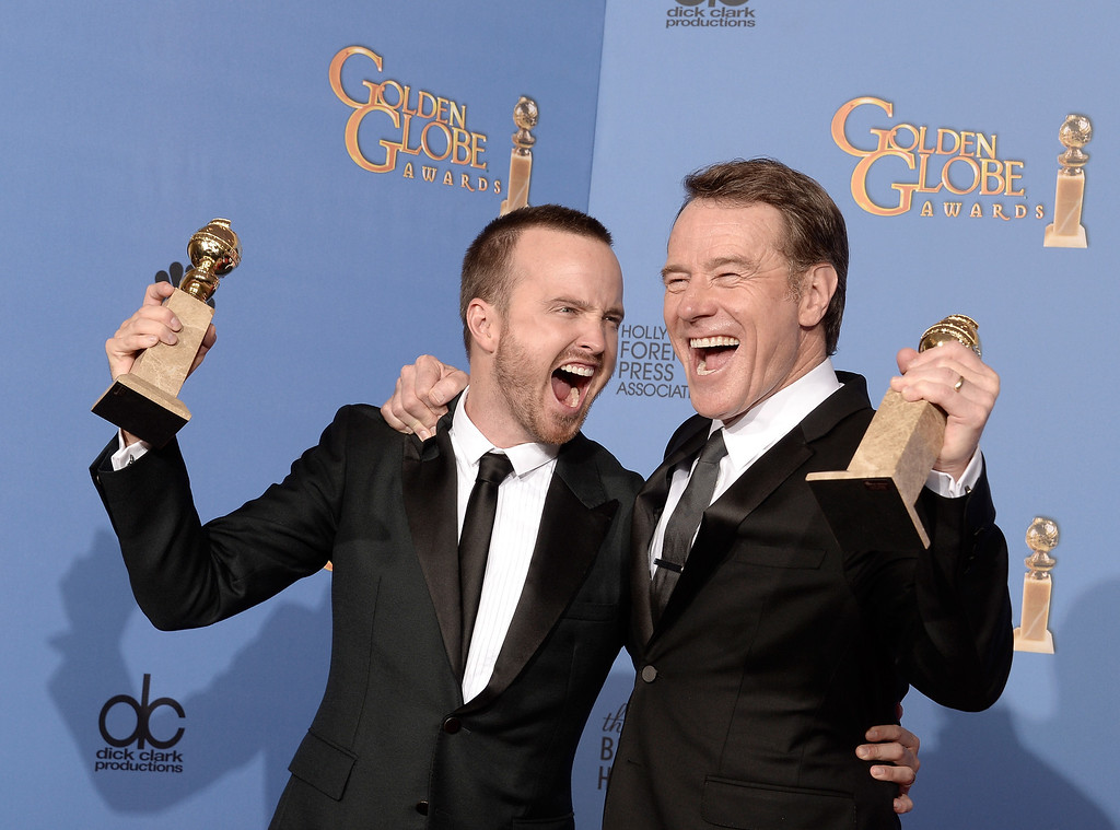 Description of . Actors Aaron Paul (L) and Bryan Cranston, winners of Best Series - Drama for \'Breaking Bad,\' pose in the press room during the 71st Annual Golden Globe Awards held at The Beverly Hilton Hotel on January 12, 2014 in Beverly Hills, California.  (Photo by Kevin Winter/Getty Images)