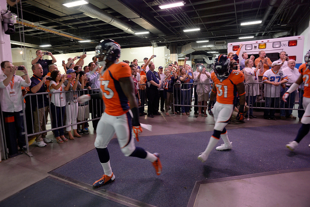Description of . The Broncos team runs through the tunnel to take the field. The Denver Broncos took on the Baltimore Ravens in the first game of the 2013 season at Sports Authority Field at Mile High in Denver on September 5, 2013. (Photo by John Leyba/The Denver Post)