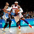 New York Knicks' Carmelo Anthony (7) drives against Denver Nuggets' Andre Iguodala during the first half of an NBA basketball game, Sunday, Dec. 9, 2012, in New York. (AP Photo/Jason DeCrow)