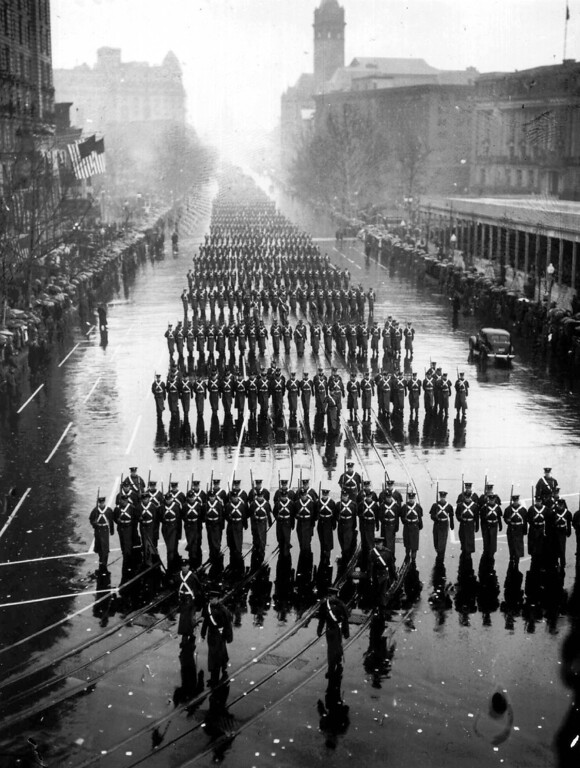 Description of . Military units splash along in the pouring rain during the inaugural parade of President Franklin D. Roosevelt Jan. 20, 1937 in Washington.  Aides tried to talk Roosevelt into moving the ceremony indoors but he looked out at the soggy crowd and replied: