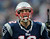New England Patriots quarterback Tom Brady yells as he runs onto the field before an AFC divisional playoff NFL football game against the Houston Texans in Foxborough, Mass., Sunday, Jan. 13, 2013. (AP Photo/Charles Krupa)
