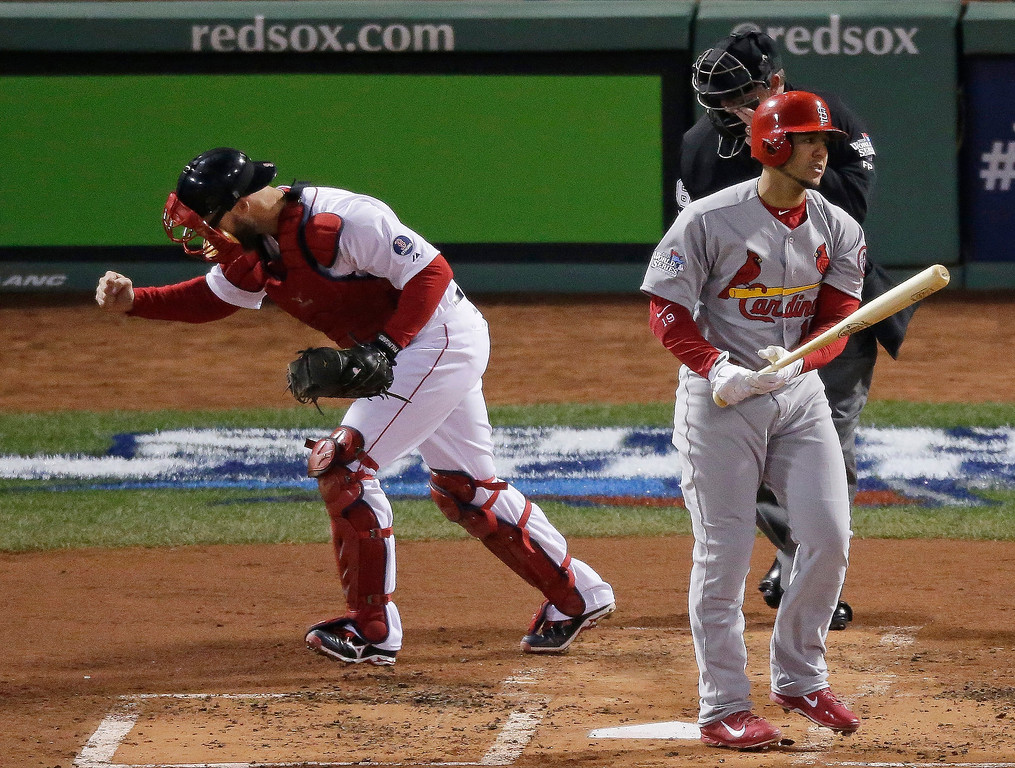 Description of . Boston Red Sox catcher David Ross (3) reacts after St. Louis Cardinals' Jon Jay strikes out to end the top of the second inning of Game 6 of baseball's World Series Wednesday, Oct. 30, 2013, in Boston. (AP Photo/Charlie Riedel)