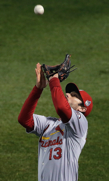 Description of . St. Louis Cardinals' Matt Carpenter catches a pop up by Boston Red Sox's Stephen Drew during the second inning of Game 6 of baseball's World Series Wednesday, Oct. 30, 2013, in Boston. (AP Photo/Chris Carlson)