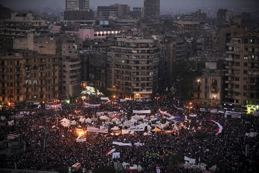 Description of . Egyptians gather during protests in Cairo, Nov. 27, 2012. Demonstrators began flowing into the streets of Cairo Tuesday for a day of protest against President Mohammed Morsi's effort to assert broad new powers, dismissing his efforts only hours before to reaffirm his deference to Egyptian law and courts. (Tara Todras-Whitehill/The New York Times)