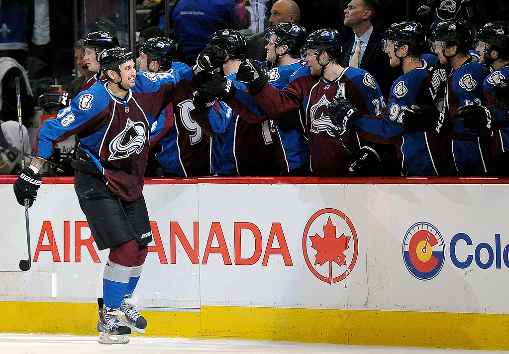 Description of . Colorado Avalanche left wing Patrick Bordeleau celebrates a goal in the third period of an NHL hockey game against the Pittsburgh Penguins on Sunday, April 6, 2014, in Denver. The Penguins won 3-2 in a shootout. (AP Photo/Chris Schneider)