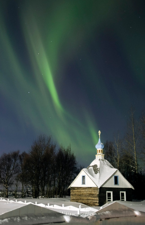 Description of . The northern lights or aurora borealis fill the western sky Friday, March 9, 2012, above the Russian Orthodox Saint Nicholas Memorial Chapel in Kenai, Alaska. The display of lights came in the aftermath of a solar storm that struck Earth on Thursday.  (AP Photo/Peninsula Clarion, M. Scott Moon)