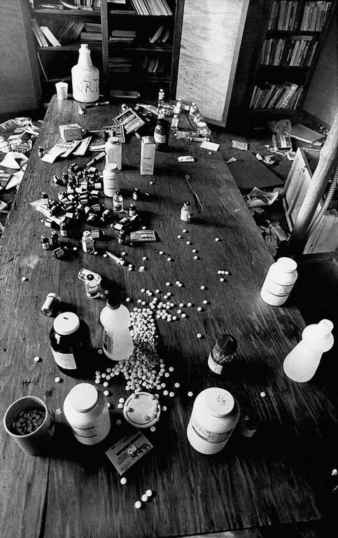 Description of . Various drugs are scattered along a table at a cult site, on Nov. 26, 1978, in Jonestown, Guyana. Investigators uncovered the large quantity of drugs while searching the home of the religious cult for victims of the mass suicide that resulted in more than 900 deaths. (AP Photo/Val Mazzenga)