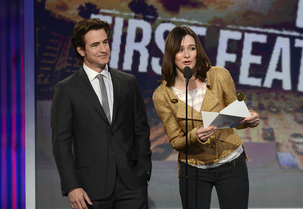 Description of . SANTA MONICA, CA - FEBRUARY 23:  Actors Dermot Mulroney (L) and Emily Mortimer onstage during the 2013 Film Independent Spirit Awards at Santa Monica Beach on February 23, 2013 in Santa Monica, California.  (Photo by Kevork Djansezian/Getty Images)