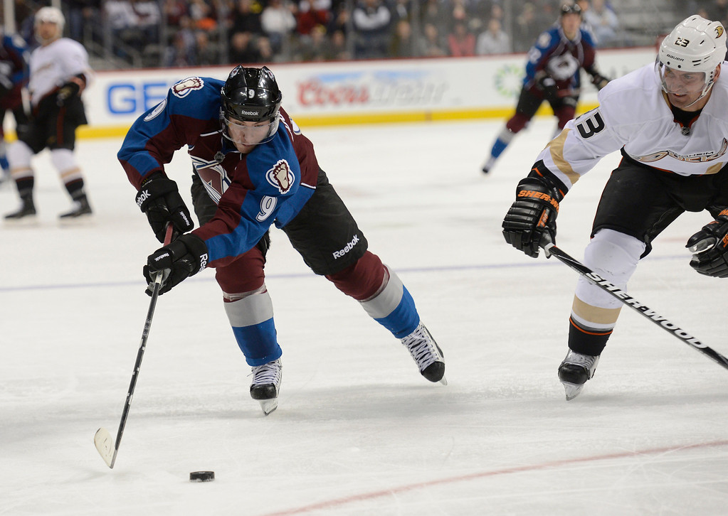 Description of . DENVER, CO. - FEBRUARY 06: Matt Duchene (9) of the Colorado Avalanche gets to the puck before Francois Beauchemin (23) of the Anaheim Ducks comes in on defense during the third period February 6, 2013 at Pepsi Center. The Colorado Avalanche fall to the Anaheim Ducks  3-0 during NHL action. (Photo By John Leyba / The Denver Post)