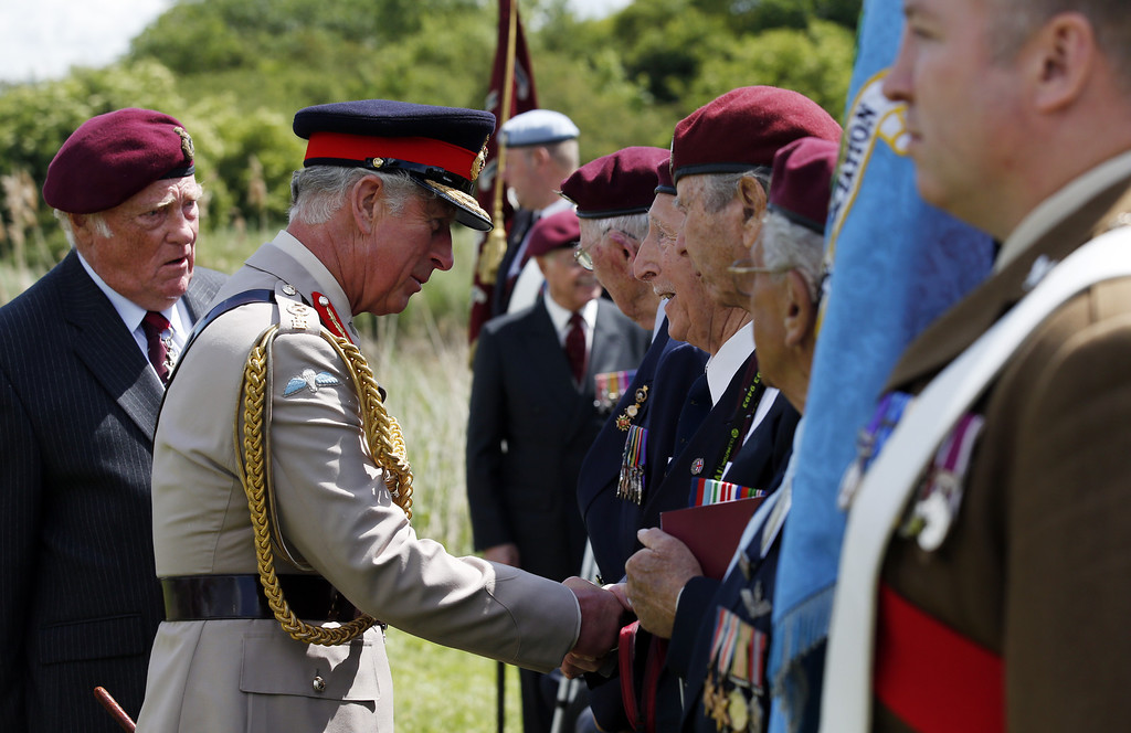 Description of . Prince Charles, Prince of Wales, Colonel-in-Chief, Army Air Corps, meets Normandy veterans of the Glider Pilot Regiment at Pegasus Bridge during the D Day 70 Commemoration on June 5, 2014 in Ranville, France.   (Photo by Jonathan Brady - WPA Pool / Getty Images)