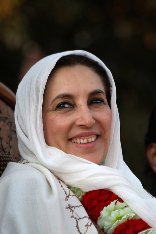 Description of . RAWALPINDI, PAKISTAN - DECEMBER 27:  Former Pakistani Prime Minister Benazir Bhutto sits on stage at a campaign rally minutes before she was assassinated in a bomb attack December 27, 2007 in Rawalpindi, Pakistan. (Photo by John Moore/Getty Images)