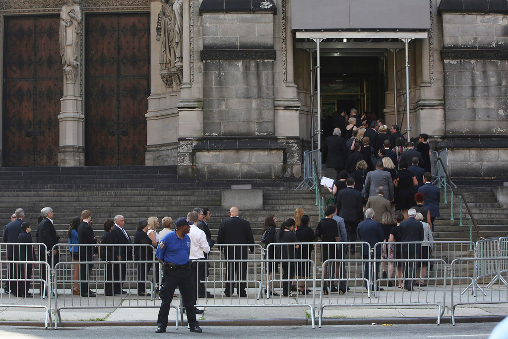 Description of . People arrive at the the Cathedral Church of Saint John the Divine for the funeral service for James Gandolfini, Thursday, June 27, 2013 in New York.   (AP Photo/Mary Altaffer)