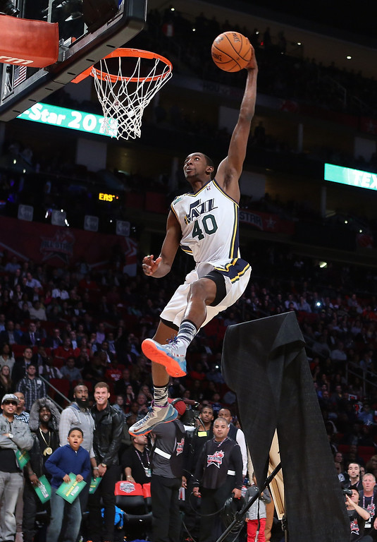 Description of . HOUSTON, TX - FEBRUARY 16:  Jeremy Evans of the Utah Jazz jumps over a painting of himself in the final round during the Sprite Slam Dunk Contest part of 2013 NBA All-Star Weekend at the Toyota Center on February 16, 2013 in Houston, Texas. (Photo by Ronald Martinez/Getty Images)