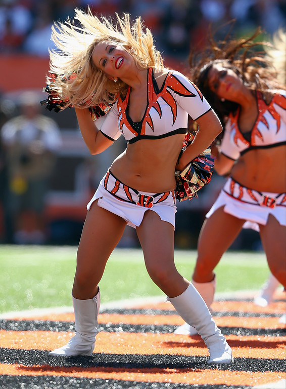 Description of . Cincinnati Bengals cheerleaders perform during the NFL game against the Green Bay Packers at Paul Brown Stadium on September 22, 2013 in Cincinnati, Ohio.  (Photo by Andy Lyons/Getty Images)
