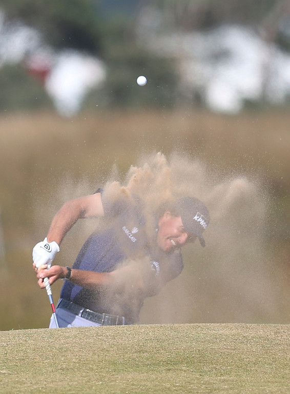 Description of . Phil Mickelson of the United States plays out of a bunker on the 15th hole during the third round of the British Open Golf Championship at Muirfield, Scotland, Saturday July 20, 2013. (AP Photo/Scott Heppell)