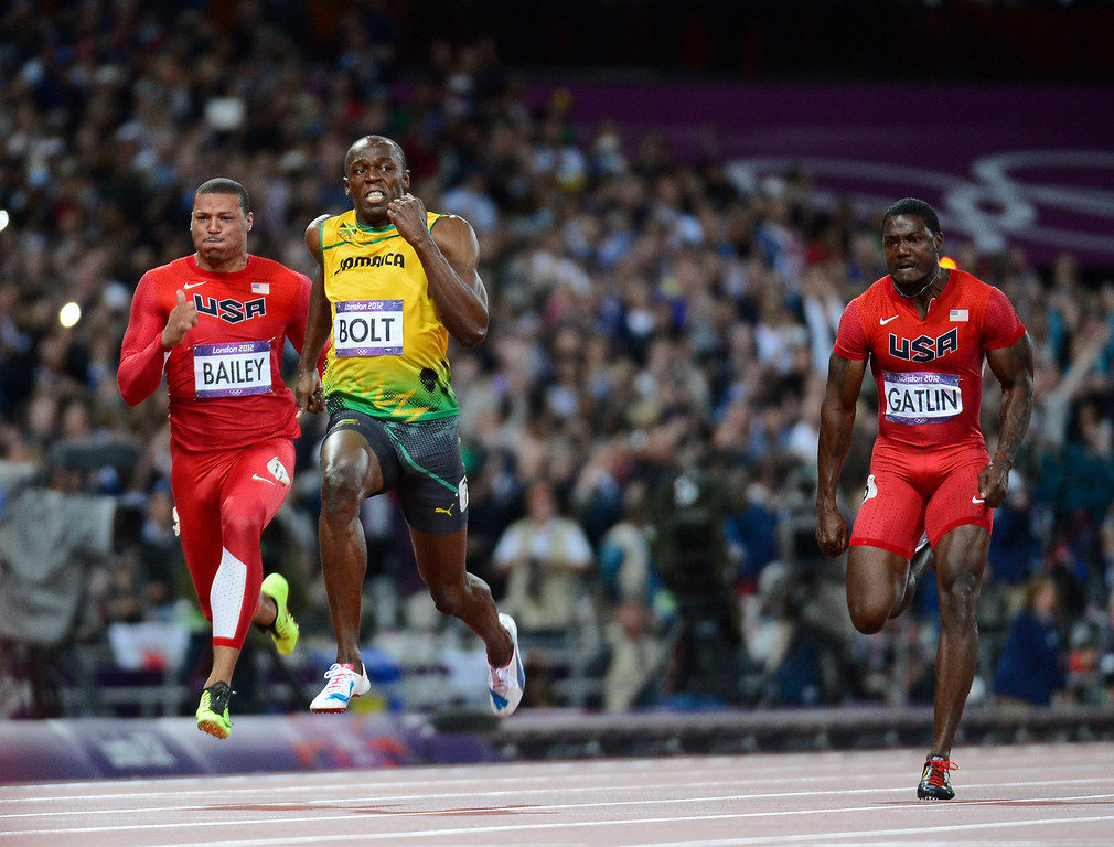 Description of . Jamaica Usain Bolt is flanked by USA Ryan Bailey and Justin Gatlin during the men's 100m final. Bolt set an Olympic Record of 9.63 seconds in the 100m, the second quickest in history Sunday, August 5, 2012 at the London 2012 Summer Games. John Leyba, The Denver Post