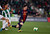 Barcelona's Lionel Messi is challenged by Cordoba's Carlos Caballero (L) during their Spanish King's Cup soccer match at Nuevo Arcangel stadium in Cordoba December 12, 2012. REUTERS/Marcelo del Pozo