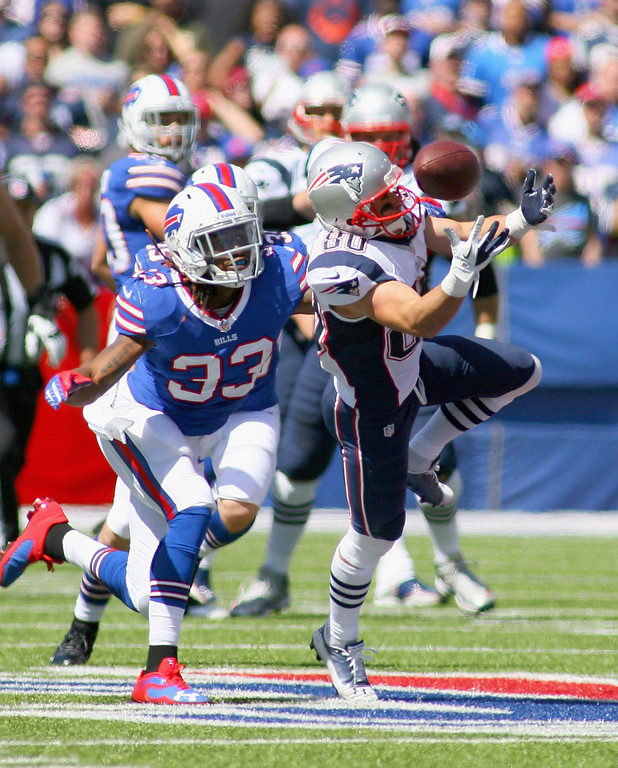 Description of . Danny Amendola #80 of the New England Patriots makes a catch against  Ron Brooks #33 of the Buffalo Bills at Ralph Wilson Stadium on September 8, 2013 in Orchard Park, New York.  (Photo by Rick Stewart/Getty Images)