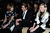Anna Wintour, Kirsten Dunst and Garrett Hedlund attend the Saint Laurent Fall/Winter 2013 Ready-to-Wear show as part of Paris Fashion Week on March 4, 2013 in Paris, France.  (Photo by Pascal Le Segretain/Getty Images)