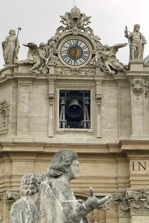 Description of . The giant bells of St Peter's Basilica ring after white smoke billowed from the chimney of the Sistine Chapel meaning that Catholic Church cardinals had elected a new leader after a conclave lasting little more than 24 hours, 19 April 2005 at the Vatican City. VINCENZO PINTO/AFP/Getty Images