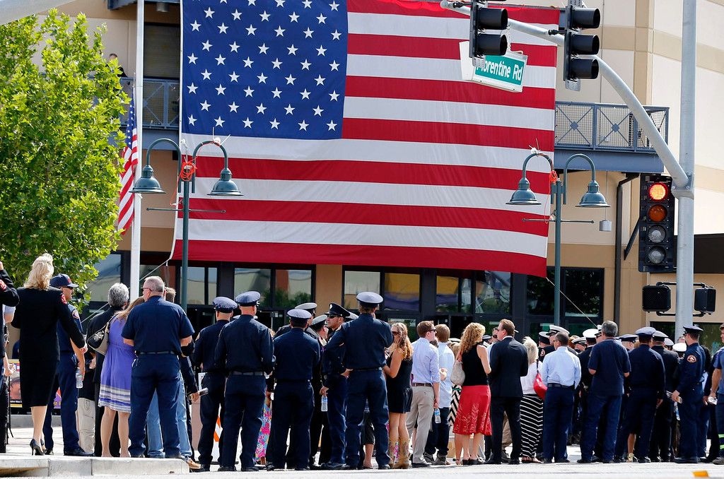 Description of . Firefighters, family and emergency personnel arrive at a memorial for the Prescott Fire Department's Granite Mountain Hotshots team in Prescott Valley, Arizona July 9, 2013.  REUTERS/Mike Blake