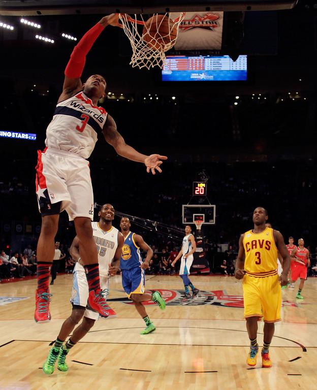 Description of . HOUSTON, TX - FEBRUARY 15:  Bradley Beal #3 of the Washington Wizards and Team Chuck dunks the ball in the BBVA Rising Stars Challenge 2013 part of the 2013 NBA All-Star Weekend at the Toyota Center on February 15, 2013 in Houston, Texas.   (Photo by Eric Gay/Pool/Getty Images)