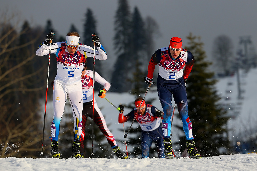 Description of . Emil Joensson of Sweden (R) and Sergey Ustiugov of Russia lead the pack in Finals of the Men's Sprint Free during day four of the Sochi 2014 Winter Olympics at Laura Cross-country Ski & Biathlon Center on February 11, 2014 in Sochi, Russia.  (Photo by Doug Pensinger/Getty Images)