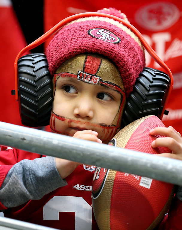 . A young fan looks on during the 2014 NFC Championship between the Seattle Seahawks and the San Francisco 49ers at CenturyLink Field on January 19, 2014 in Seattle, Washington.  (Photo by Christian Petersen/Getty Images)