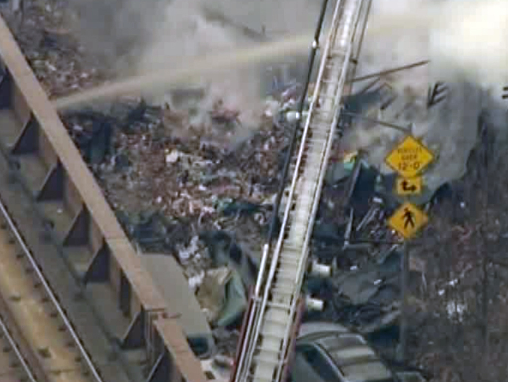Description of . In this image taken from video from WABC, firefighters battle a blaze at the site of a possible explosion and building collapse in the East Harlem neighborhood of New York, Wednesday, March 12, 2014. (AP Photo/WABC-TV)