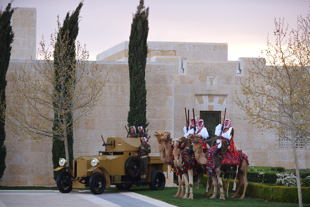 Description of . Honor guard sit on camels near an antique armored personnel carrier during a welcome ceremony for the arrival of US President at Al-Hummar Palace on March 22, 2013 in the Jordanian capital Amman.   AFP PHOTO/MANDEL NGAN/AFP/Getty Images