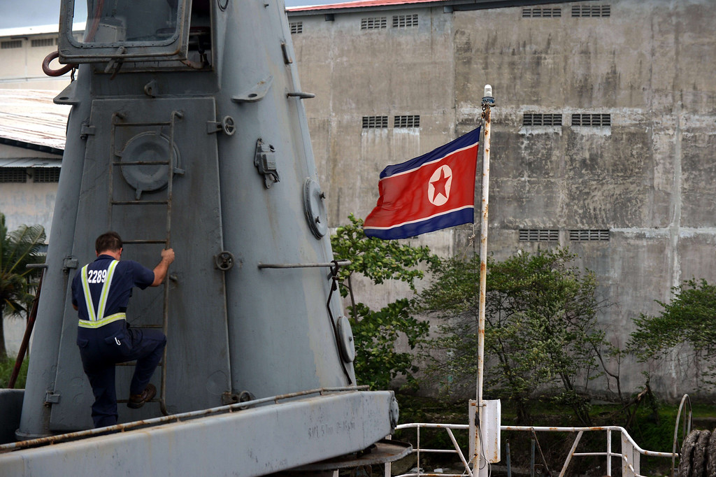 Description of . A member of the Panamanian air and sea police officer inspects North Korean vessel Chong Chong Gang at Manzanillo harbor in Colon, 90km from Panama City on July 16, 2013.  AFP PHOTO / Rodrigo ARANGUA/AFP/Getty Images