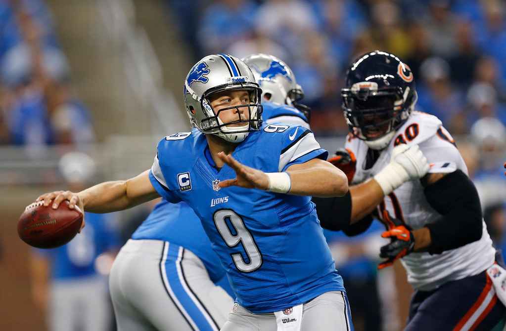 Description of . Detroit Lions quarterback Matthew Stafford (9) throws during the first quarter of an NFL football game against the Chicago Bears at Ford Field in Detroit, Sunday, Sept. 29, 2013. (AP Photo/Paul Sancya)