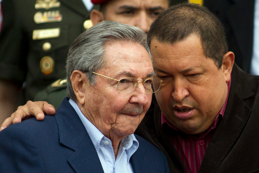 Description of . Venezuelan President Hugo Chavez (R) and his Cuban counterpart Raul Castro talk after the ALBA (Boliviarian Alternative for the Americas) summit in Caracas February 5, 2012. REUTERS/Carlos Garcia Rawlins