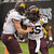 Minnesota's Philip Nelson, left, congratulates Rodrick Williams (35) after he scored a touchdown against Texas Tech during the first quarter of the Meineke Car Care Bowl NCAA college football game, Friday, Dec. 28, 2012, in Houston. (AP Photo/Dave Einsel)